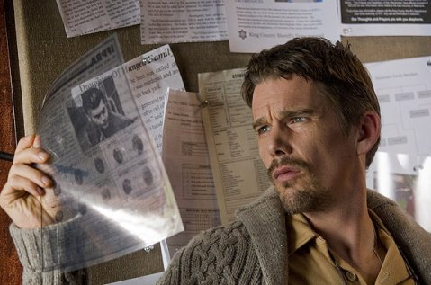 Sinister - Ethan Hawke Looking Over Evidence