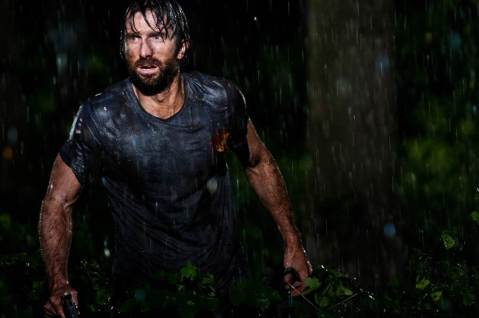 open-grave-Sharlto-Copley-singing-in-the-rain